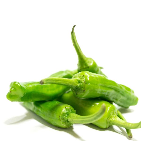 Green Baklouti chilis on a white background