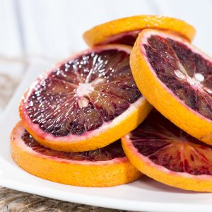 Fresh Blood Orange slices on white plate