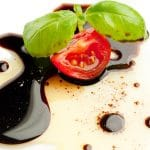 Olive oil balsamic vinegar tomato and basil