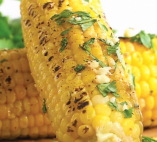Cultivated Tree Grilled Corn on the Cobb with cilantro and Parmesan cheese.