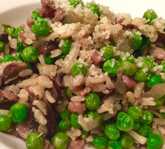 Cultivated Tree Olive Oil Brown Basmati Rice, Fresh Peas, Baby Bella mushrooms and more in a white bowl.